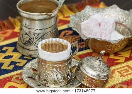 Turkish coffee with coffee pot and turkish delights