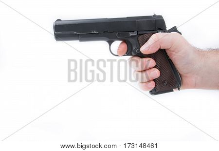 male hand holding pistol handgun isolated on white background