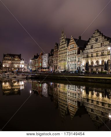 GHENT BELGIUM - 18TH FEB 2016: Ghent from the Graslei and Korenlei at night. The facades of buildings can be seen.
