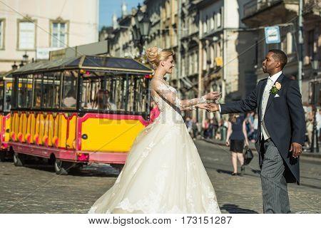 Happy African American Groom And Cute Bride Dancing On Street