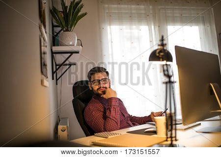 Shot of a young business man working in his office.