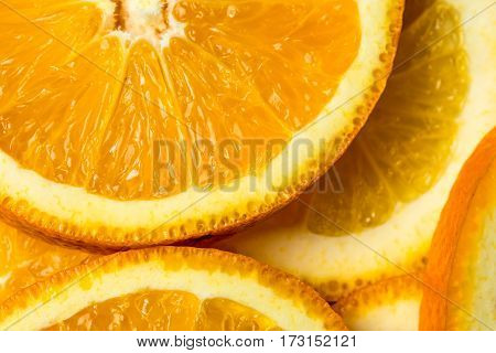 Fresh cut orange fruit background, many pieces of oranges, macro close up photo of healthy food, top view