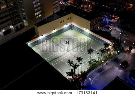 Lights are on at night at a resorts tennis courts