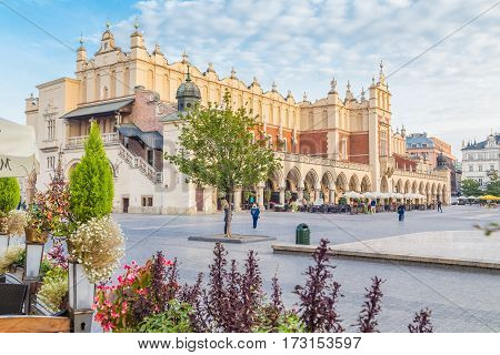 KRAKOW POLAND - 15TH OCTOBER 2016: Cloth Hall and Rynek Glowny in Krakow in the morning. People can be seen.