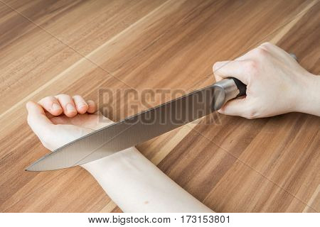 Woman wants to cut her vein with knife. Suicide concept.