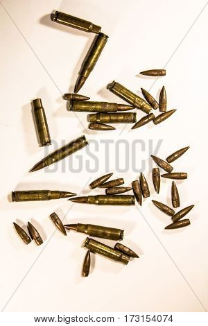 Bullets scattered around as war crime criminal army military weapon arm violence death protection concept background