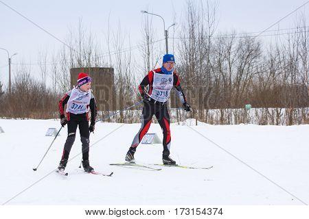 Kirishi, Russia - 11 February, Skiers of all ages, 11 February, 2017. Mass ski race Russian Ski Track.