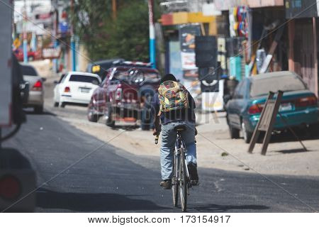 Bicycle rider on side of road in chimaltenango Guatemala Central America.