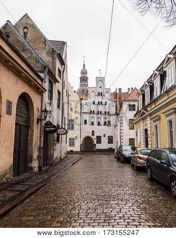 RIGA LATVIA - 2ND JAN 2017: A view along streets in Riga Old Town towards Three Brothers (Tris brali) and Riga Cathedral.