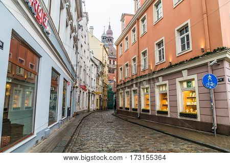 RIGA LATVIA - 1ST JAN 2017: A view along streets in Old Town Riga towards the Riga Dome Cathedral at during the day.