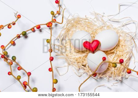 Easter card with eggs and biscuits in the form of hearts close up.