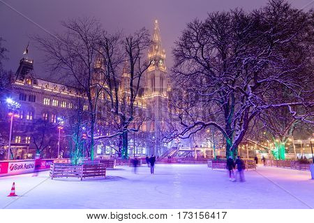 VIENNA AUSTRIA - 1ST FEB 2017: Wiener Eistraum (Vienna Ice World) at Rathausplatz in the winter. Rathaus (City Hall) can be seen in the distance.