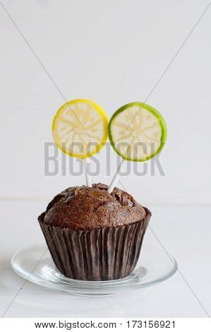 Birthday chocolate muffin with a citrus lollipop