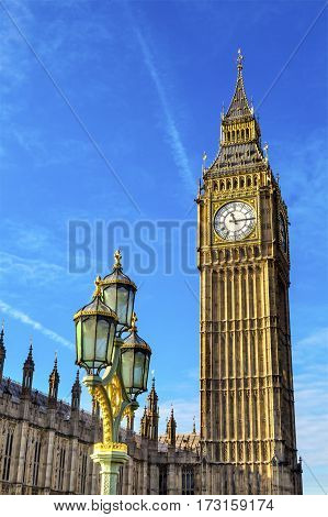 Big Ben Tower Houses of Parliament Lamp Post Westminster Bridge Westminster London England. Named after the Bell in the Tower. Has kept exact time since 1859.