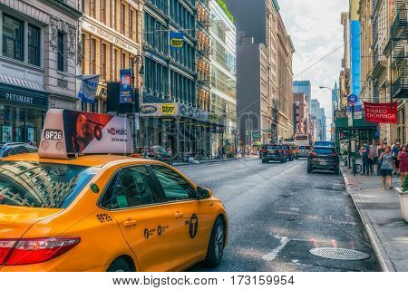 NEW YORK CITY, USA : Buildings and street traffic on the Broadway.It is the oldest north-south main thoroughfare in New York City, dating to the first New Amsterdam settlement.