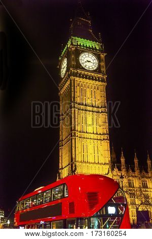 Big Ben Tower Red Bus Westminster Bridge Night Houses of Parliament Westminster London England. Named after the Bell in the Tower. Has kept exact time since 1859.
