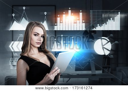 Portrait of a businesswoman with a tablet computer standing in an office with six graphs on a glassboard. Toned image.