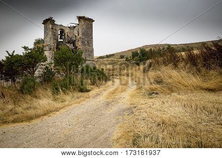 ruins of Virgen del Rosario church on a cloudy summer day in Villalval, Burgos, Spain