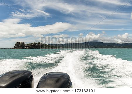 speed boat motor water wave Beautiful rock and sea with blue sky in Koh Samui Thailand