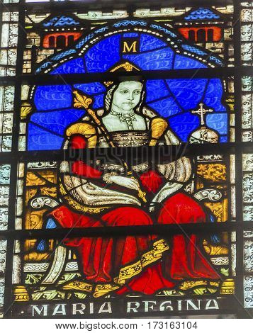 LONDON, ENGLAND - JANUARY 16, 2017 Queen Bloody Mary Stained Glass 13th Century Chapter House Westminster Abbey Church London England. Mary was queen from 1153 to 1558 before Elizabeth. Her executions of Protestants gave her the Bloody name. Westminister