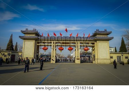 BEIJING, CHINA - 29 JANUARY, 2017: Entrance gate to temple of heaven compund, an imperial complex with various religious buildings located in southeastern central city area, nice blue sky.