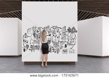 Rear view of a woman drawing a sketch in an art gallery interior. White walls concrete floor and wooden ceiling. Concept of modern art exhibition. 3d rendering mock up