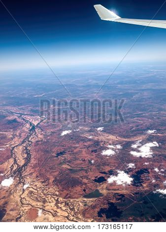 Flying high above the Australian outback. Atmospheric haze and internal reflections make for a challenging shooting condition.