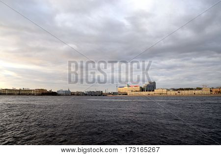 View of center of St Petersburg at evening. Arsenal embankment Vyborg side and Sampson bridge.