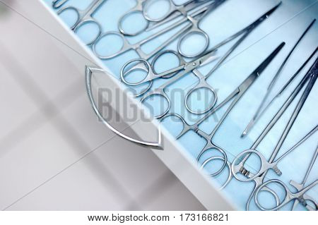 Veterinary Surgical Tools Lying In Drawer. Steel Medical Instruments