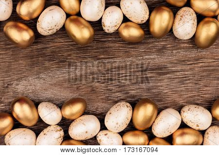 White And Gold Easter Egg Double Border Against A Rustic Wood Background