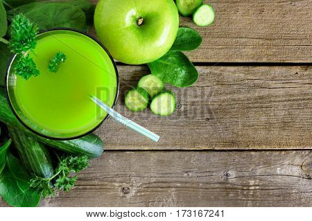 Glass Of Fresh Green Vegetable Juice, Downward Scene Over A Rustic Wood Background