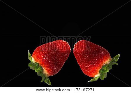 Juicy ripe red strawberries with green leaves