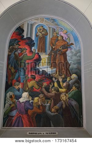 SHKODER, ALBANIA - SEPTEMBER 30: Frescoes that depict the persecution of religion in socialist Albania, St Stephen's Cathedral in Shkoder, Albania on September 30, 2016.