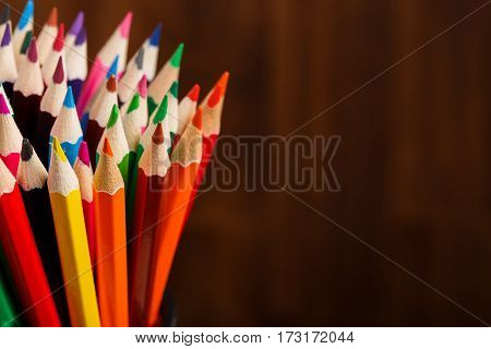 Color pencils on wood background close up , Color pencils Background texture. Bunch of colorful pencils. Place for the text. Eucation, art, design. Painting and drawing.