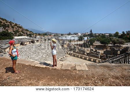 Demre Antalya Turkey - august 28 2014: Roman amphitheatre in Myra ancient capital of Lycia near Demre Lycian Coast Turquoise Coast Anatolia Turkey Asia.