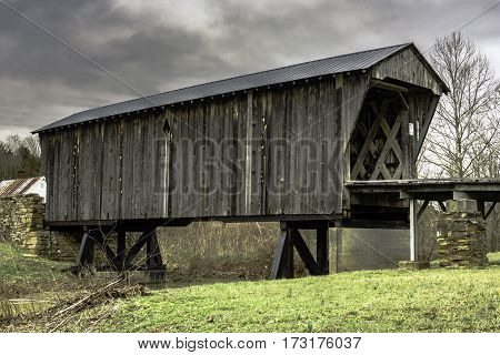 February 26 2016: Goddard Kentucky - Goddard White Bridge the only surviving example of Ithiel Town Lattice design in Kentucky. The timbers are joined with wooden pegs.