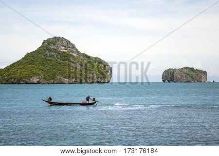 Koh Samui Thailand Ang thong national park Traditional a row fisherman boat anchored