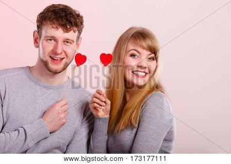 Pair Holding Love Symbols.