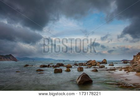 A rocky coastline looking out over the south China sea in Vung Lam Bay Vietnam.