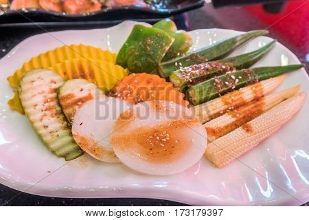 Closeup of mix vegetable garnish on white plate