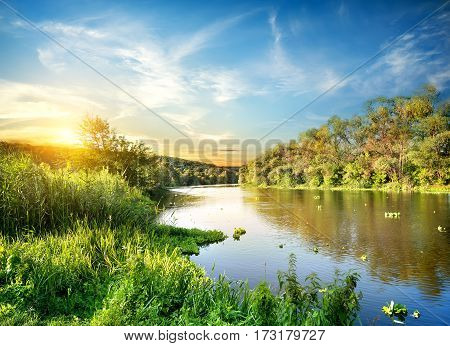 Sunrise over the river Severskiy Donets in the forest