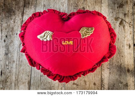 Valentines day greeting card concept with hearts on wooden background.
