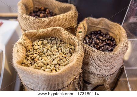 Closeup of white coffee beans with gunny bag background