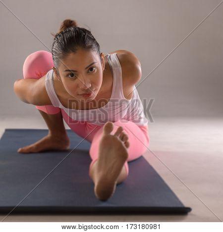 Young woman doing yoga for balance body.