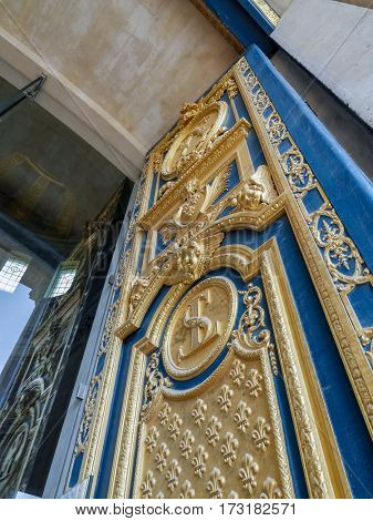 Ornamental door of the Saint-Louis-des-Invalides Cathedral, part of The National Residence of the Invalids also known as Hotel des Invalides, Paris, France