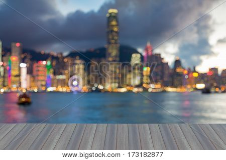 Opeing wooden floor Blurred light Hong Kong city downtown office building sea front abstract background