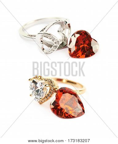 Pile of heart shaped wedding rings isolated over the white background, set of two different foreshortenings