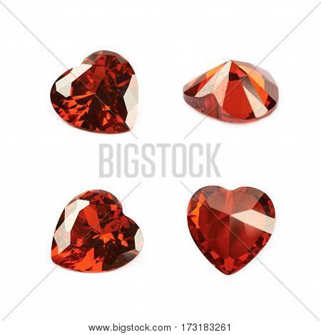 Heart shaped red gem stone isolated over the white background, set of four different foreshortenings