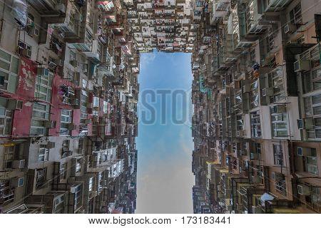 Hong Kong citt apartment from bottom view cityscape background