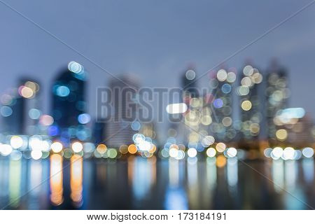 City bokeh lights and water reflection night view abstract background